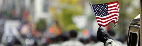 armed-serviceman-at-veterans-day-parade-h